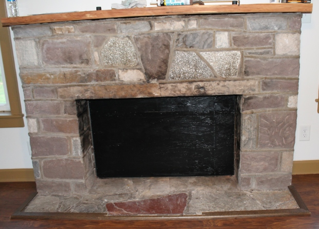 Original fire place had a metal hook to hold the kettle for cooking.  The Dillon family converted it but due to chimney problems, it can't be used for wood fires.